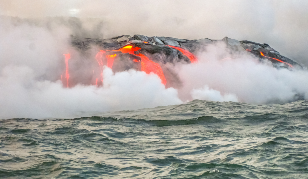 Close up picture of the volcano in the sea with lava coming out.