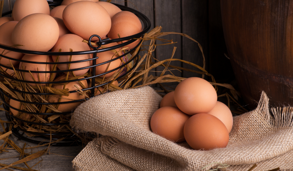 Eggs inside the basket and on the cloth.